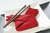Asian place-setting with red napkin and chopsticks