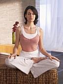 Woman sitting cross-legged practising yoga