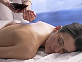 Woman having a massage with massage oil