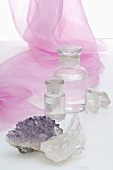 Quartz crystals, amethyst and apothecary bottles