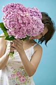 Woman holding bunch of hydrangeas