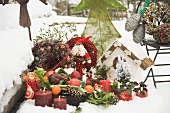 Christmas decorations in snowy garden