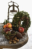 Rustic Christmas decorations on wooden table out of doors