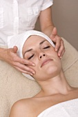 Woman having beauty treatment (face massage)
