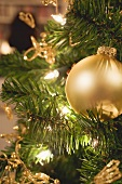 Gold Christmas tree ornament and fairy lights