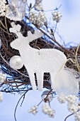 White reindeer on Christmas wreath (close-up)