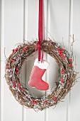 Christmas door wreath with red boot