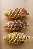 Three fir cones (Christmas tree ornaments)