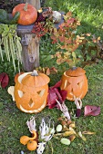 Autumnal garden decoration with pumpkins, corncobs & leaves