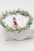 Christmas tree ornament and wreath on Christmas parcel
