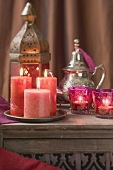 Middle Eastern decoration: candles, windlights, lantern, teapot