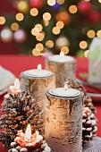 Burning candles on Christmas table