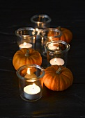 Autumnal table decoration: pumpkins and windlights