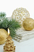 Gold candles and Christmas baubles