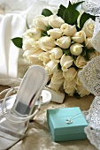 Wedding bouquet of white roses, wedding shoes & jewellery