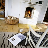 A chair, a book and a cup of tea in front of an open fire