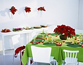 Festive table with poinsettia, buffet