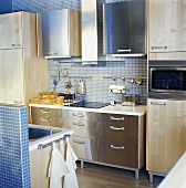 Kitchen with blue tiles