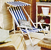 Blue and white striped deckchair on a terrace