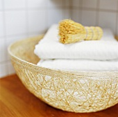 Basket of towels and brushes