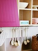 Kitchen cupboard and kitchen utensils