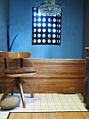 Wooden chair in front of blue wall