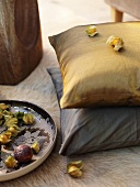 Cushions and exotic fruit on carpet