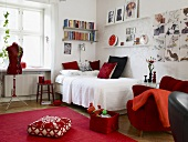 Bedroom decorated in red and white