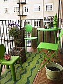 Balcony of a city flat with garden ornaments