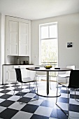 Kitchen with black & white floor tiles & furniture (Sweden)