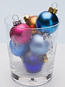 Coloured Christmas baubles in festive glass