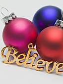 Coloured baubles and the word 'Believe' (tree ornaments)