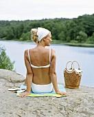 Blond woman sunbathing