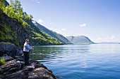 Man fishing in Gratangen Fjord, Norway