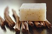 Bar of flavour soap on cinnamon sticks, close-up
