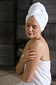 Germany, woman wearing towel turban