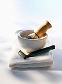 Shaving brush, shaving foam, disposable razor, close up