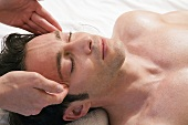 Man receiving facial massage