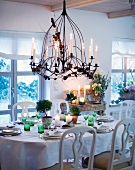 Table laid for special occasion in country home