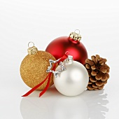 Assorted Christmas baubles and cone