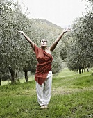 Woman doing yoga in olive grove