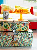 A stack of brightly patterned cases as a bedside table