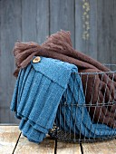 Warm clothing and blanket in metal basket
