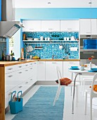 White and turquoise kitchen-dining room