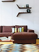 Living room with striped cushion on brown sofa and retro style carpet