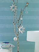 Branch decorated with Christmas baubles