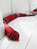 A red checked draught-excluder snake