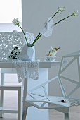 White table with extravagant vase and chair