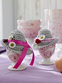 Easter decorations: egg cups decorated with crocheted hats