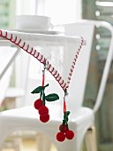 Crocheted cherry tablecloth clips